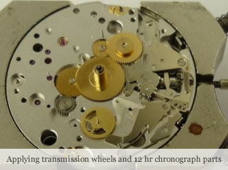 <p>&nbsp;Applying transmission wheels and 12 hr chronograph parts</p>